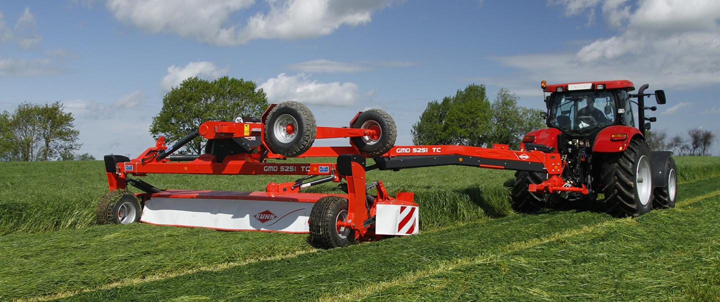KUHN GMD 5251 TC large-width trailed disc mower on the road