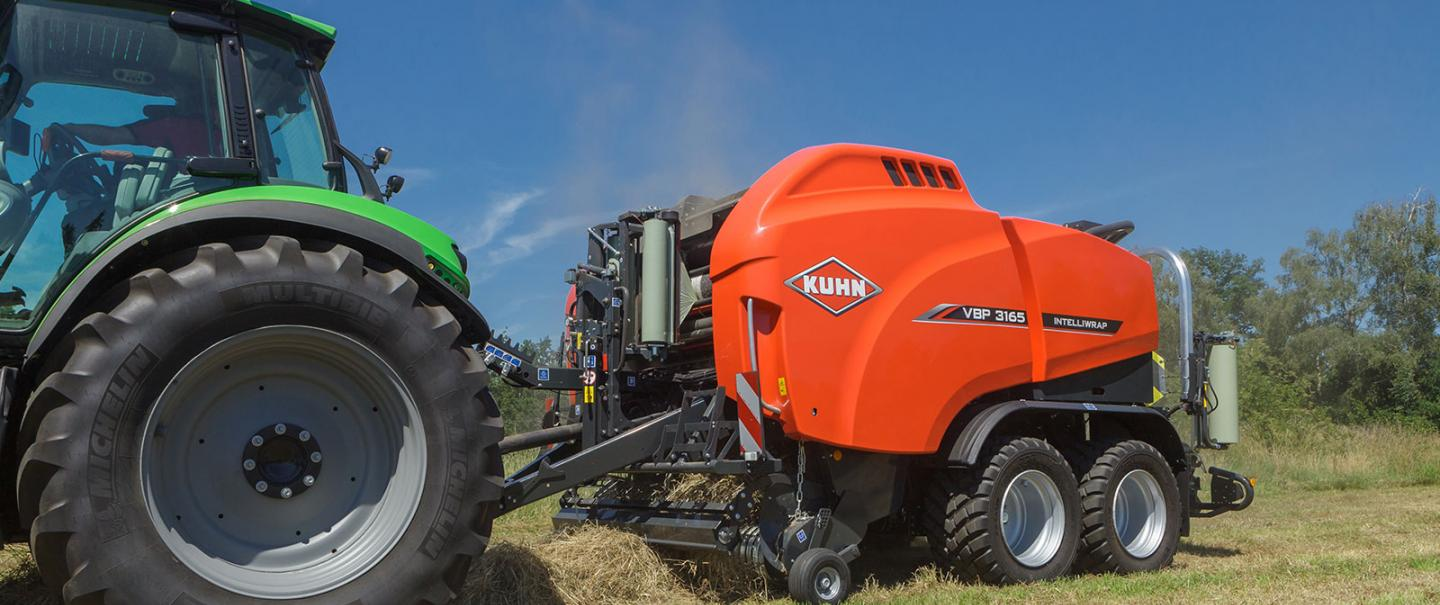 VBP 3165 baler wrapper combination leaving a field with wrapped bales.